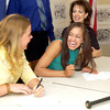 Spring Hill High School's Kristen Gaddis, left, and Kristen Akin laugh about Akin's fake letter of intent Friday, April 30, 2004. Gaddis will be playing softball for Abilene Christian while Akin will join the UT Tyler program. (Les Hassell/News-Journal Photo)