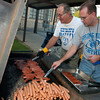 Spring Hill Jr. High Assistant Principal, left, and History Teacher Mark Bourdon grill hot dogs for the Hot Dog Super and Open House.  The Student Activity Fund provided hot dogs and refreshments for students and their parents before meeting with teachers. (Jennifer Soliz/News-Journal Photo)