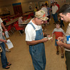 Boy Scout District Director, David Guerra, right, helps Mickey Mitchell register his grandson, Isaiah Mitchell, age 6, for Cub Scouts in Ore City.  Guerra recruits for the Boy Scouts in Gregg, Upshur, and Halsville counties. (Jennifer Soliz/News-Journal Photo)