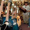 Reyes Vasquez and his son, age 9, look at the guitar selection at Mundt Music in Longview.  Vasquez is an amateur guitar player, and he is thinking of purchasing one soon.  (Jennifer Soliz/News-Journal Photo)