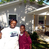 Eyvonne Evers, center, poses for a photo with her sons Davadrick Lilly, 11, left, and Feuquan Lilly, 12, right,  outside their home on South Fredonia Tuesday Agust 31, 2004 in Longview. Kevin Green