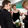 David Aylor, left, and Kasey Crenshaw help Hunter Cippele adjust his handkerchief before Saturday's, February 28, 2004 Senior Celebration at Longview High School. (Les Hassell/News-Journal Photo)