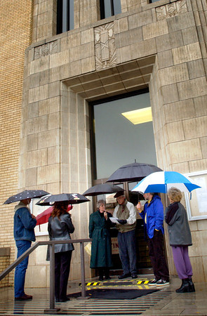 Dana and Don Knoop, center, lead a group in prayer on the steps of the Gregg County Courthouse Sunday, February 29, 2004.  (Les Hassell/News-Journal Photo)