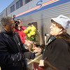 Amtrak's Longview relief agent Pat Rickcalton, left, presents Connie Miller with flowers after getting off the train Monday January 19, 2004 in Longview. Miller is the sixth-grade teacher at Antigo Middle School in Antigo, Wis., who is responsible for AMS the stuffed dog who rode the train. Kevin green