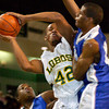 Longview's #42 drives to the basket during Friday's, January 30, 2004 game against  the John Tyler Lions. (Les Hassell/News-Journal Photo)