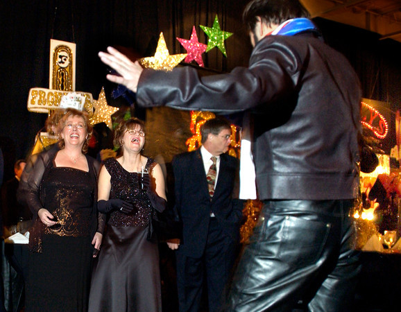 Elvis impersonator Jerry Meyer entertains guests at the Las Vegas-themed Laird Memorial Hospital Foundation Annual Gala Saturday, January 31, 2004 in Kilgore. (Les Hassell/News-Journal Photo)
