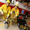 Members of the White Oak fire department Payton Hass, left, and Dennis Carr, right with the city's new Jaws of Life equipment at the fire station Thursday January 29, 2004 in White Oak. Kevin Green