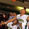 Longview Lobos and John Tyler Lions battle for a rebound during Friday's, January 30, 2004 game. (Les Hassell/News-Journal Photo)
