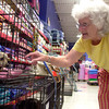 Carole Anderson greets a mix chihuahua at petco ,Saturday, July 31,2004 during a pick of the litter adoption program. Ricardo B. Brazziell