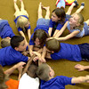 Seventh and eighth graders participate in a stretching excise during a Kids care after school program given by USA Camp fire Wednesday, June 30, 2004 at pine tree middle school. Ricardo B. Brazziell