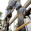 Muchael Pirtle, with Mullins Drywall, of Pritchett, walks about eight and a half feet tall on his stilts while working on a building Tuesday June 29, 2004 in Kilgore. Kevin green
