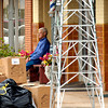 Olen Holder sits on a bench outside of the Modern Barber Shop as trash bags and boxes are piled on the corner in preparation of trash pick-up Tuesday June 29, 2004 in downtown Kilgore. Kevin Green