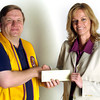 Brian Whitenack, with the Judson Lions Club presents a $500 check to Roxanne Hutson, right, the exucutive director of the Humane Society of Gregg County, INC. News Journal Photo