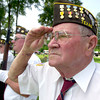 Navy veteran John Hines stands and salutes as the national anthem is played during the Memorial Day dedication at Rosewood Park Patriots Gardens May 31, 2004.  Hines is a member of the VFW 4002 Honor Guard.(Darlene Chapman-Davis/News-Journal Photo)