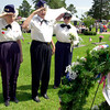 North East Texas Women's Veterans Vi Hammett,left, Mozelle Barton, and Bette Williams stand and salute after placement of the wreath during Memorial Day Dedication at Rosewood Park May 31, 2004.(Darlene Chapman-Davis/News-Journal Photo)