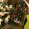 Good Shepherd Medical Center Volunteer Coordinator, Pat Watson, places decorated Christmas trees on a display table in the lobby of Good Shepherd.  The Festival of Trees will begin today from 8a.m. to 5p.m. and on December 2, 2004 from 8a.m. to 4p.m.  The bidding for the trees starts at $35, and all profits will benefit the Good Shepherd Auxiliary.   (Jennifer Soliz/News-Journal Photo)