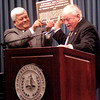 """LeTourneau University President Dr. Alvin O. Austin, left, accepts a plaque from Keith Thayer, right, the ASME past president, during a ceremony celebrating the R. G. LeTourneau """"Mountain Mover"""" Monday November 29, 2004, at the university in Longview. Kevin Green"""