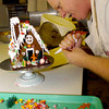 Dennis Bass works on decorating a gingerbread house at Golden Flake Bakery Tuesday November 30, 2004 in Longview. Kevin Green