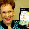 Clara Payne with her book. Kevin Green