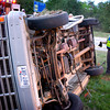 Trooper Roy Tower pieces together parts of a blown out tire during his investigation of an accident on I-20, north of Kilgore, Sunday, October 31, 2004. Ten (???) members of a Kilgore church were transported to the hospital. (Les Hassell/News-Journal Photo)