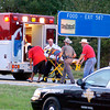 Rescue workers transport a victim to an ambulance at the scene of an accident on I-20, north of Kilgore, Sunday, October 31, 2004. Ten (???) members of a Kilgore church were transported to the hospital. (Les Hassell/News-Journal Photo)