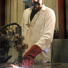 Mike Montesinos, in costume as a 70's dude, demonstrates the plasma ark cutting process Sunday afternoon during LeTourneau University Materials Joining Open House.  October 31, 2004.  Michael Cavazos/News-Journal Photo