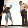 New Diana High School junior Greg Johnson, trys his hand at standing on one leg with drunk goggles at .20 alcohol content while Upshur County Sheriff's deputy Don Gross, right, looks on during a program Friday, April 29, 2005 in Diana.  (Kevin Green/News-Journal Photo)