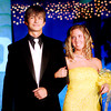 Charlie Ogden (left) a Senior at Longview High School, Escorts Longview High School Senior Erin Rutledge(right) down the main isle on Satruday. April 30, 2005 at Longview High School's Senior Celebration at Lobo Colesium in Longview. (Courtney Case/News-Journal Photo)