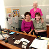 Sisters Sandi Rice Mulkey, left, and Dana Rice, right, pose for a photo with their mother Ernestine Rice, back, at the office Wednesday April, 27, 2005 in Longview. (Kevin Green/News-Journal Photo)
