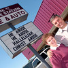 The Service Station owner Lance Chambliss, right, with his mother Joan Chambliss, left, in front of their sign Wednesday, April 27, 2005 at the business in Longview.  (Kevin Green/News-Journal Photo)