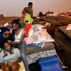 Hurricane Evacuees Alicia Pierre, left, sits patiently while her sister Veronica Pierre, right, both of Metairie, LA.,  braids her hair Wednesday, August 31, 2005 at the Red Cross Shelter at Maude Cobb Convention and Activity Center in Longview.  (Kevin Green/News-Journal Photo)