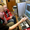 Carthage High School juniors Kyle Cage, left, and Kari Patton, right, edit a short movie on a computer Wednesday, August 31, 2005 at the school in Carthage.  (Kevin Green/News-Journal Photo)