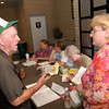 Red Cross volunteer of six years Melodee Overton, of Big Sandy, right, visits with Hurricane Katrina evacuee Frank McKnight, left, of New Orleans,  as he checks into the shelter Wednesday, August 31, 2005 at Maude Cobb Convention and Activity Center in Longview. Frank'a wife Melva Knight was in the hospital after having a heart attack at 3am Wednesday in Marshall. (Kevin Green/News-Journal Photo)