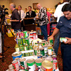Longview Fire Department fireman Erasmo Lopez, with station #2 sorts can goods while a press conference gets under way Wednesday, August 31, 2005 at the Red Cross Shelter at Maude Cobb Convention and Activity Center in Longview.  (Kevin Green/News-Journal Photo)