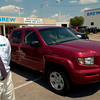Brew Honda owner David Houston stands next to a Honda Ridgeline truck Tuesday, August 30, 2005 at the dealership in Longview.