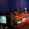 Carthage High School senior Ashley Wade, left, and junior Kari Patton, right, visit on camera Wednesday, August 31, 2005 at the school in Carthage.  (Kevin Green/News-Journal Photo)