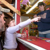 Kelly Bumbard, 6, of Tyler, picks out fireworks Friday night with her family at the Fantastic Fireworks stand on Highway 289.  Chris Baker, who runs the stand says that business has been slightly slower than expected this holiday season likely due to local burn bans. (Luisa Morenilla/News-Journal Photo)