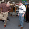 Monty McDaniel assists Joe Stroud of Tyler as he tests out a  pair of shoes at Brown's Shoe Fit Company on Judson Road. (Luisa Morenilla/News-Journal Photo).