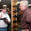 Monty McDaniel, the assistant manager of Brown's Shoe Fit Company on Judson Road, helps Joe Stroud of Tyler find the right pair of shoes. (Luisa Morenilla/News-Journal Photo)