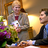 John Stossel, of ABC's 20/20, chats with Paul and Jeanie Folzenlogen, of Longview, during a book signing session Monday, February 28, 2005 at Pinecrest Country Club. The journalist and author will speak at the University of Texas at Tyler's Cowen Center as part of te Distinguished Lecturer Series on Tuesday. (Les Hassell/News-Journal Photo)