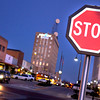 One of the new stop signs on Tyler St. glows against the evening sky Monday, February 28, 2005. Bring the whole family downtown for an amazing, awe-inspiring evening of watching the lights come on. (Les Hassell/News-Journal Photo)