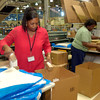 Nieman Marcus employee Jeanette McMillan, left, prepares items to be shipped to a store Monday, February 28, 2005 in Longview. Kevin Green