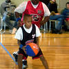 Daqualyn O'Neal #24 of Longview(age10) tries to elude Jason Harris on Longview #32 in a Church recreation Programs and Community Outreach Programs for PROGRESS basketball game on Saturday, January 29, 2005 at First Baptist Church ROC Center in Longview.(Courtney Case/News-Journal Photo)
