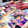 Alison Campbell, of Ore City, works on a colorful scrapbook Saturday, January 29, 2005 during a scrapbook cropping fund-raiser for the American Cancer Society at the Ramada Inn. (Les Hassell/News-Journal Photo)