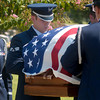 Master Sgt. Nordyica Woodfolk, salutes the casket at the funeral for Maj. Arthur Dale Baker, who's plane was shot down over Laos in 1965 during the Vietnam War. The serviceman's body was lost for almost 40 years. Earlier this year, U.S. investigators matched a bone fragment with DNA from his family.  (AP Photo/Kevin Green/Longview News-Journal)