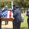 Master Sgt. Nordyica Woodfolk, salutes the casket at the funeral for Maj. Arthur Dale Baker, who's plane was shot down over Laos in 1965 during the Vietnam War. The serviceman's body was lost for almost 40 years. Earlier this year, U.S. investigators matched a bone fragment with DNA from his family.  (Kevin Green/News-Journal Photo)