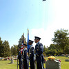 A United States Air Force color guard stands at attention as a B-52 Bomber flys-over during the funeral for Maj. Arthur Dale Baker, who's plane was shot down over Laos in 1965 during the Vietnam War. The serviceman's body was lost for almost 40 years. Earlier this year, U.S. investigators matched a bone fragment with DNA from his family.  (Kevin Green/News-Journal Photo)