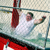 Deputy Chief Mark Dickerson of Henderson flys into the water as the one of the atractions of the dunking booth on Saturday, July 30, 2005 during the Henderson Block Party in Downtown Henderson. (Courtney Case/News-Journal Photo)