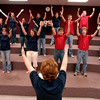 White Oak High School choir director Ruthie Vinson leads the choir in rehearsal Tuesday, Kune 28, 2005 at the school in White Oak.  (Kevin Green/News-Journal Photo)