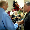 "Dorothy Box, 83, center,  a survivor of the 1937 New London school explosion, applauds as Henderson mayor J.W. ""Buzz"" Fullen, left, and Mark Maine shake hands Monday, June 27, 2005 at Henderson's city hall. Maine is chairman of Angelic Entertainment who is behind the production of a feature movie chronicling the tragic event. (Les Hassell/News-Journal Photo)"
